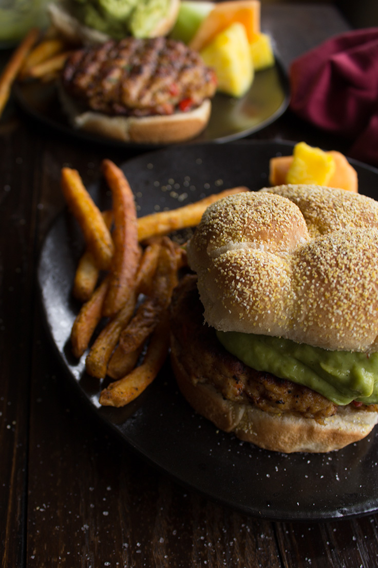 These spicy chicken burgers are loaded with homemade guacamole and perfectly spicy peppers.