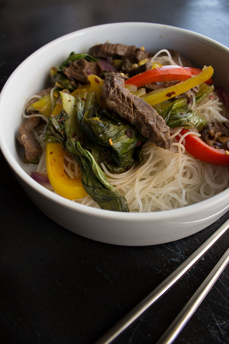 This spin on spicy beef and baby bok choy is on the table in under 20 minutes for the perfect weeknight dinner.