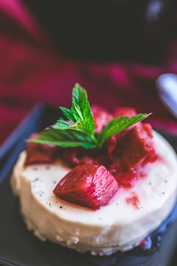 Simple vanilla panna cotta is paired with a perfectly tangy and sweet fruit compote of strawberries, rhubarb and vanilla bean. | insolenceandwine.com