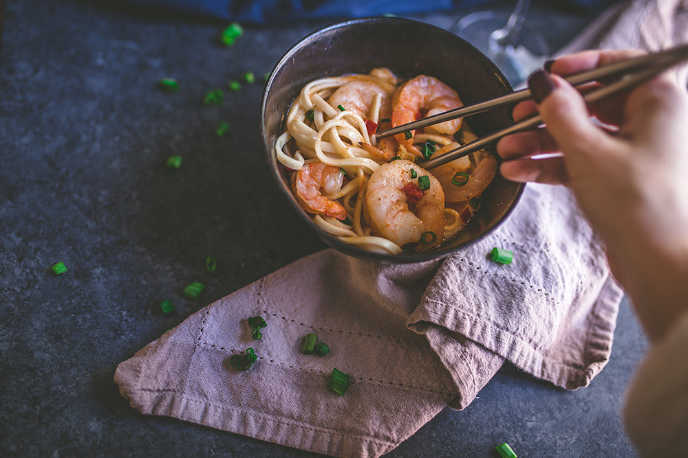A light but warming winter spicy coconut shrimp soup with udon noodles.