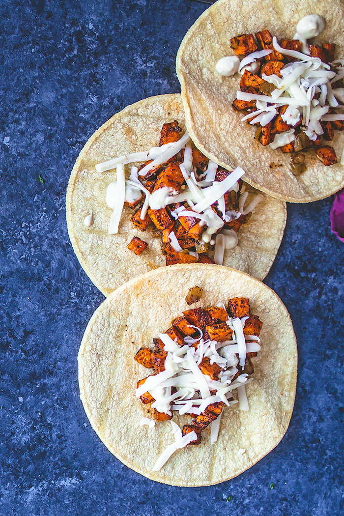 Vegetarian roasted sweet potato and green chile tacos are a great meatless Taco Tuesday option.