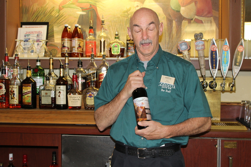 In this photo, Ron is holding a bottle of wine from Grand Canyon Wineries. The vineyards are not actually in the Grand Canyon (that would be a stupid thing to ask, right? Really? Shut up). They're not in Arizona at all. They're in California. I smell a Xanterra plot fermenting...