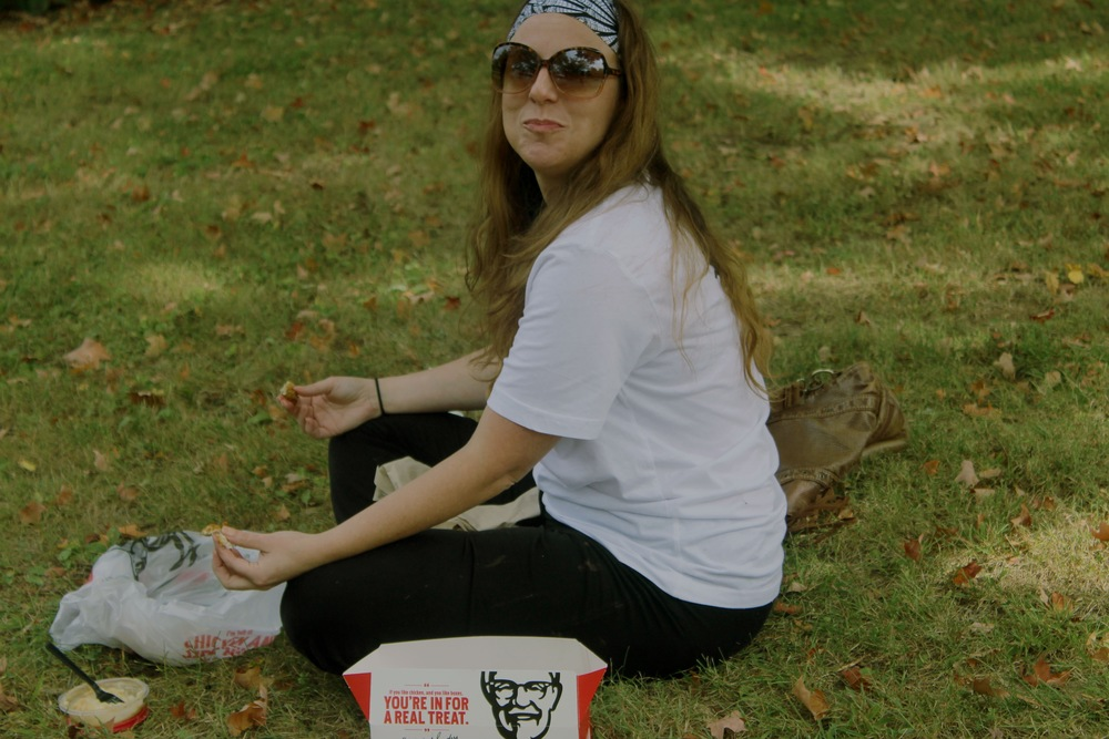 Girl Eating KFC At Colonel Sanders' Grave, Louisville, Kentucky