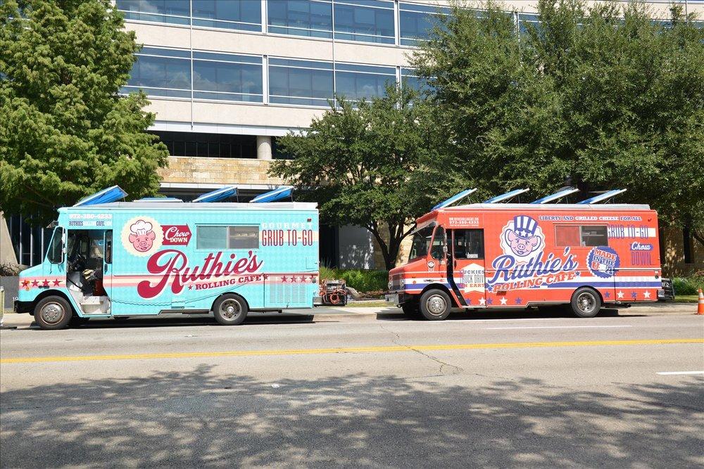 website photo of 2 trucks.JPG