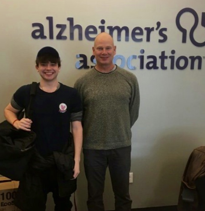 Ruthie's employee, Cully, delivering grilled cheese sandwiches to the staff of the Greater Dallas Chapter of the Alzheimer's Association.