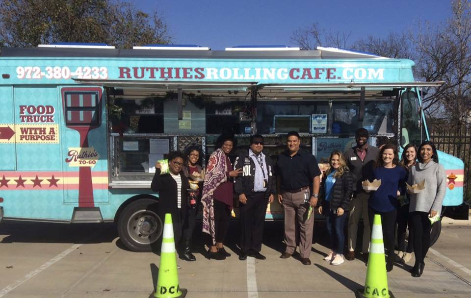 The staff of DCAC enjoying lunch from Ruthie's Rolling Cafe!