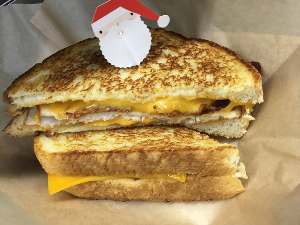 Smoked sliced turkey, crispy bacon, house made slob sauce, and melted sharp cheddar cheese on grilled sourdough bread topped with Santa! The Turkey Trot was one of the grilled cheese sandwiches delivered during the 12 Days of RSK's.