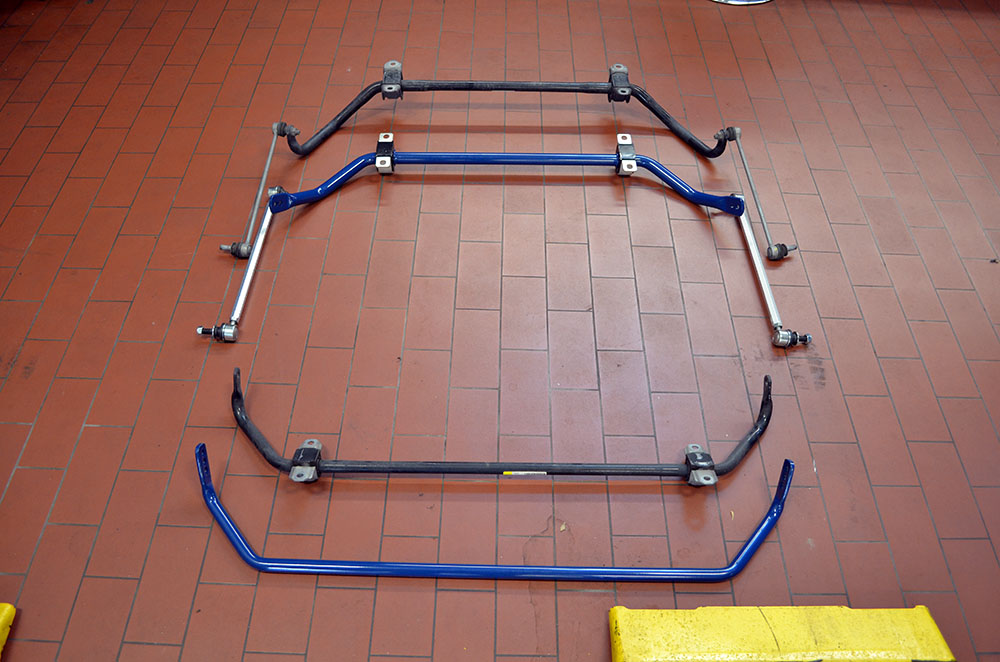 Side-by-side comparison of the factory and Dinan anti-roll bars.