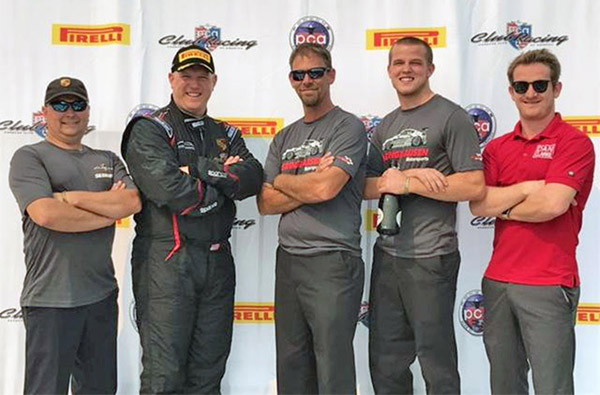 Kevin Maxim on the Road America Podium with coach Dan Clarke and Isringhausen technicians Jimmy Cardoni, David Drake and Dillon Cox