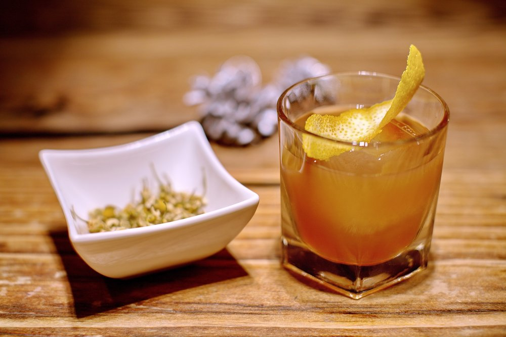 Chamomile Old Fashioned - Chamomile Infused Bourbon, Muddled Ginger, Agave NectarThis is a crowd favorite.  A simple Old-Fashioned with a slight twist.  The chamomile enriches the bourbon and mellows the burn.