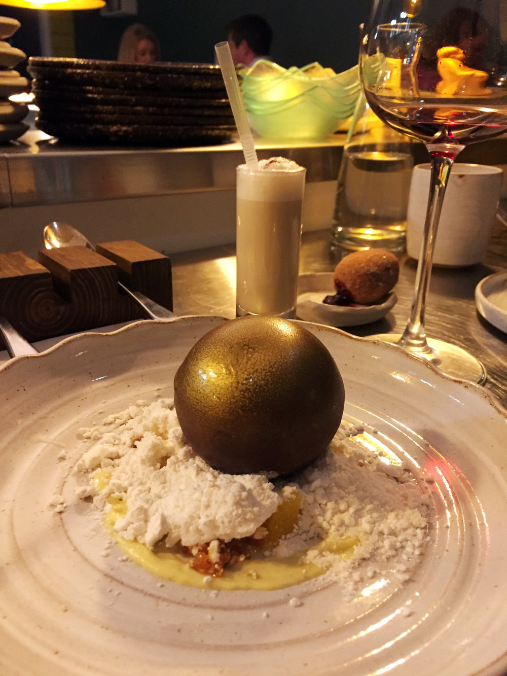 "(Foreground) Milk Chocolate ""Bauble"", Orange and Popcorn (Background) Eggnog with Damson Jam Doughnut"