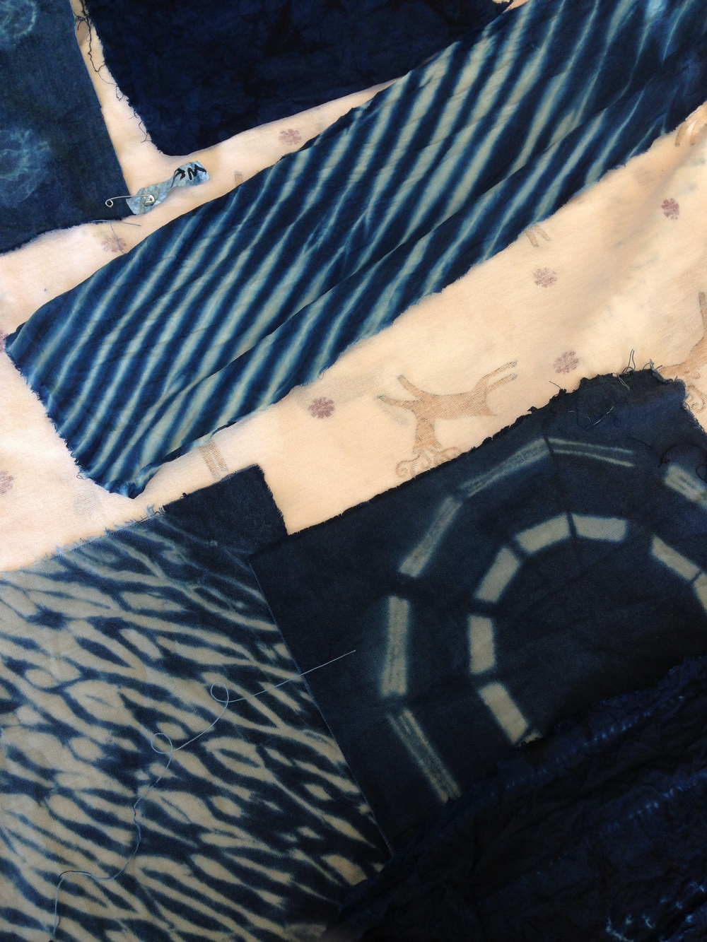 Student work drying at the Shibori scarf workshop