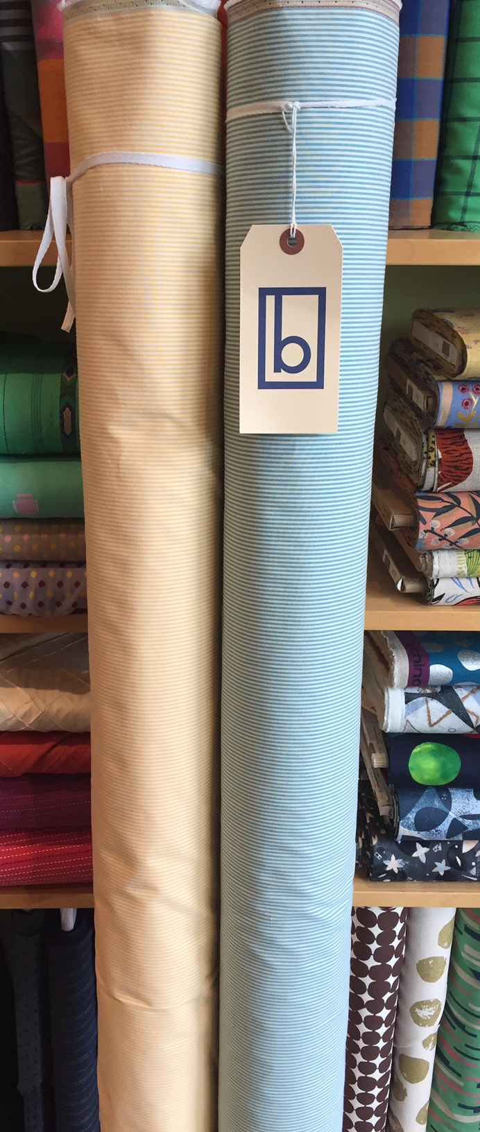 Cotton stretch pin cord suiting in two spring-summer colors.