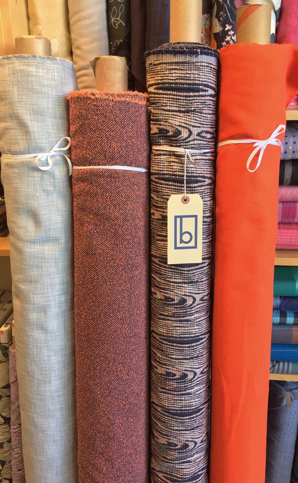 Textured cotton solids, cotton boucle, cotton jacquard.