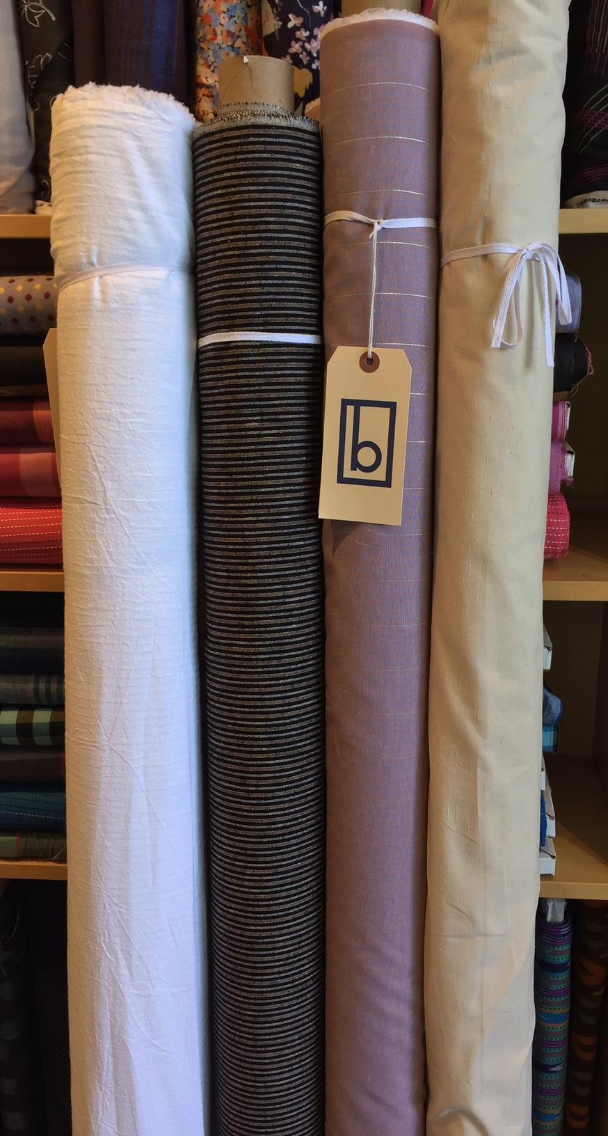 (L to R): light weight cotton subtle stripe, linen blend dark stripe, cotton stripe with metallic accent, cotton slub solid