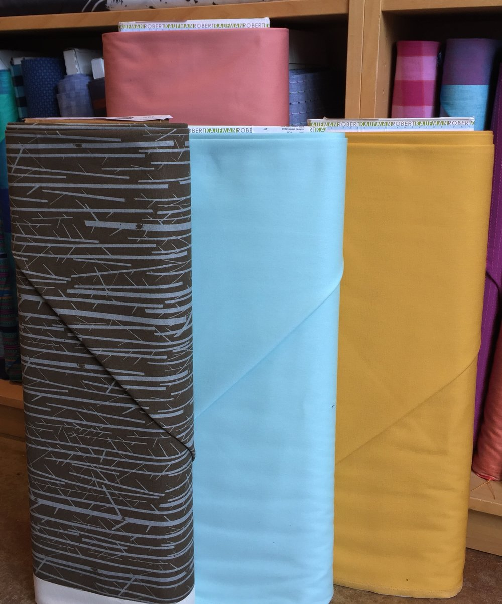 A new, fresh color of Robert Kaufman's stretch twill--a gorgeous bottom or coat weight, in dusty peach. Aqua and curry colored denim! And an organic cotton canvas, a la Charley Harper.