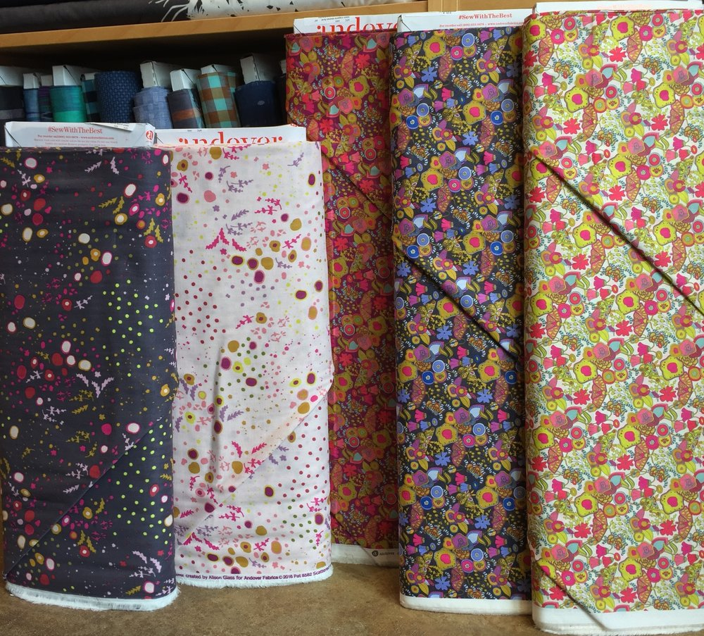 A pair of lively floral double gauze prints on the left and three bright floral cotton lawns on the right.