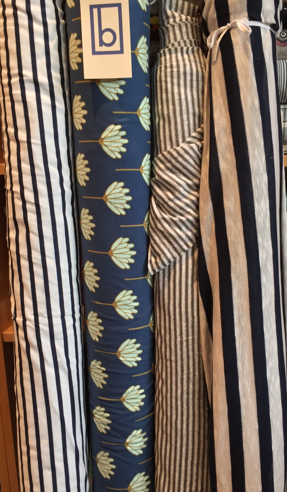 Stripes, stripes, stripes and flowers. More knits, of various weights, contents and drape. From left to right: mid-weight cotton, cotton/spandex, linen, and rayon.