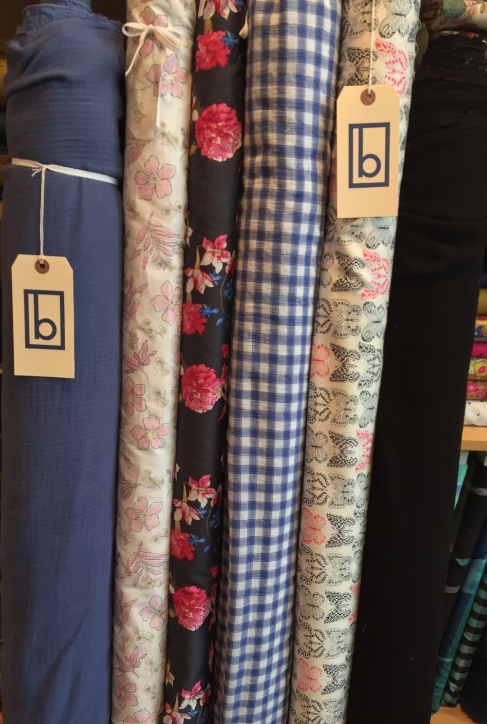 More interesting apparel goodies: super soft, herringbone double ply blue cotton, blossom eyelet print, bright floral lawn, gauzey blue check, crisp cotton butterfly and stretchy, black rayon gauze.