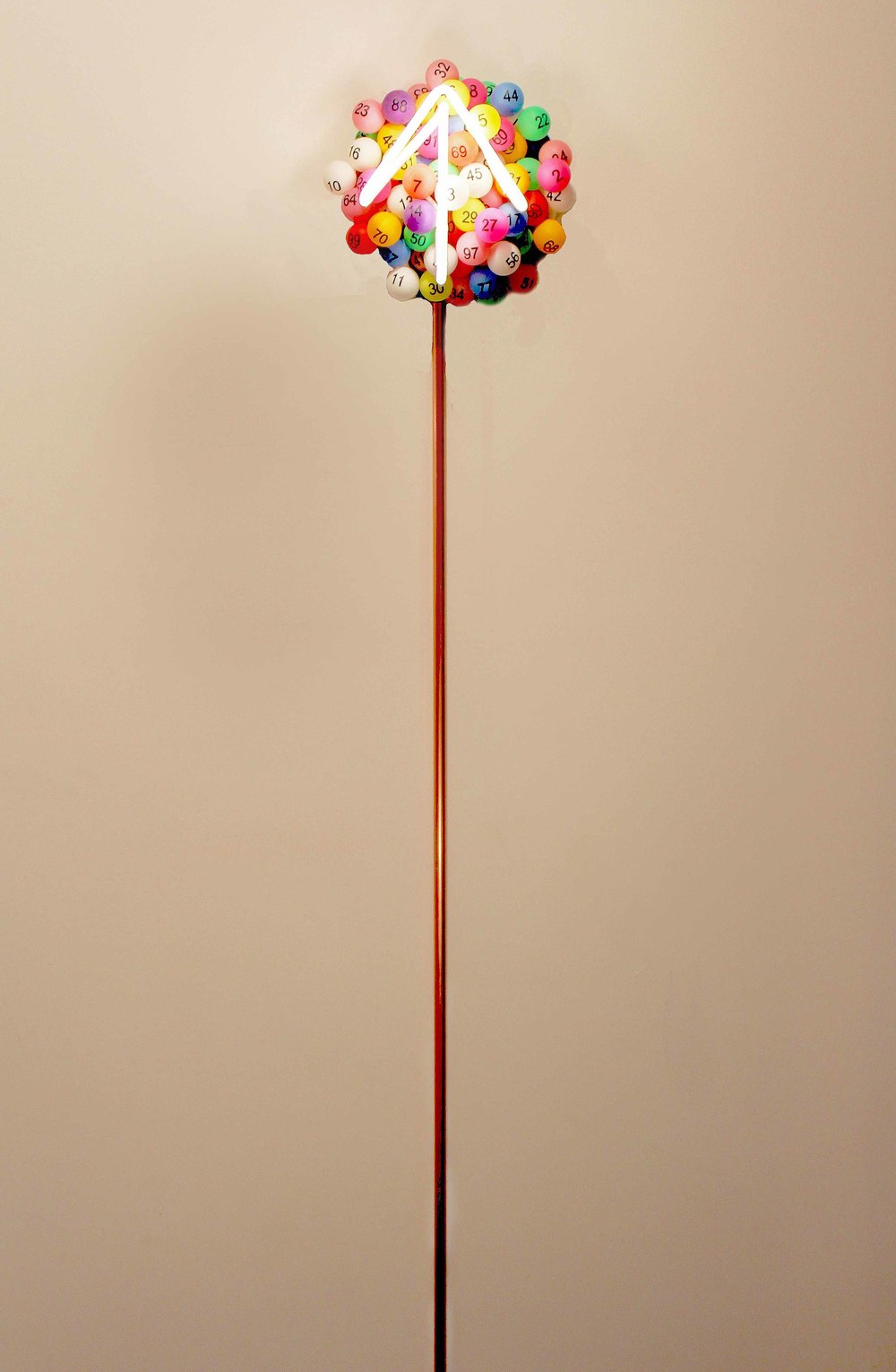 "Chance, 2016. Neon, lottery balls, and copper. 10 x 10 x 4 inches. Top fixture has a 10"" diameter and the entire piece is 6' tall. Hangs from wall."
