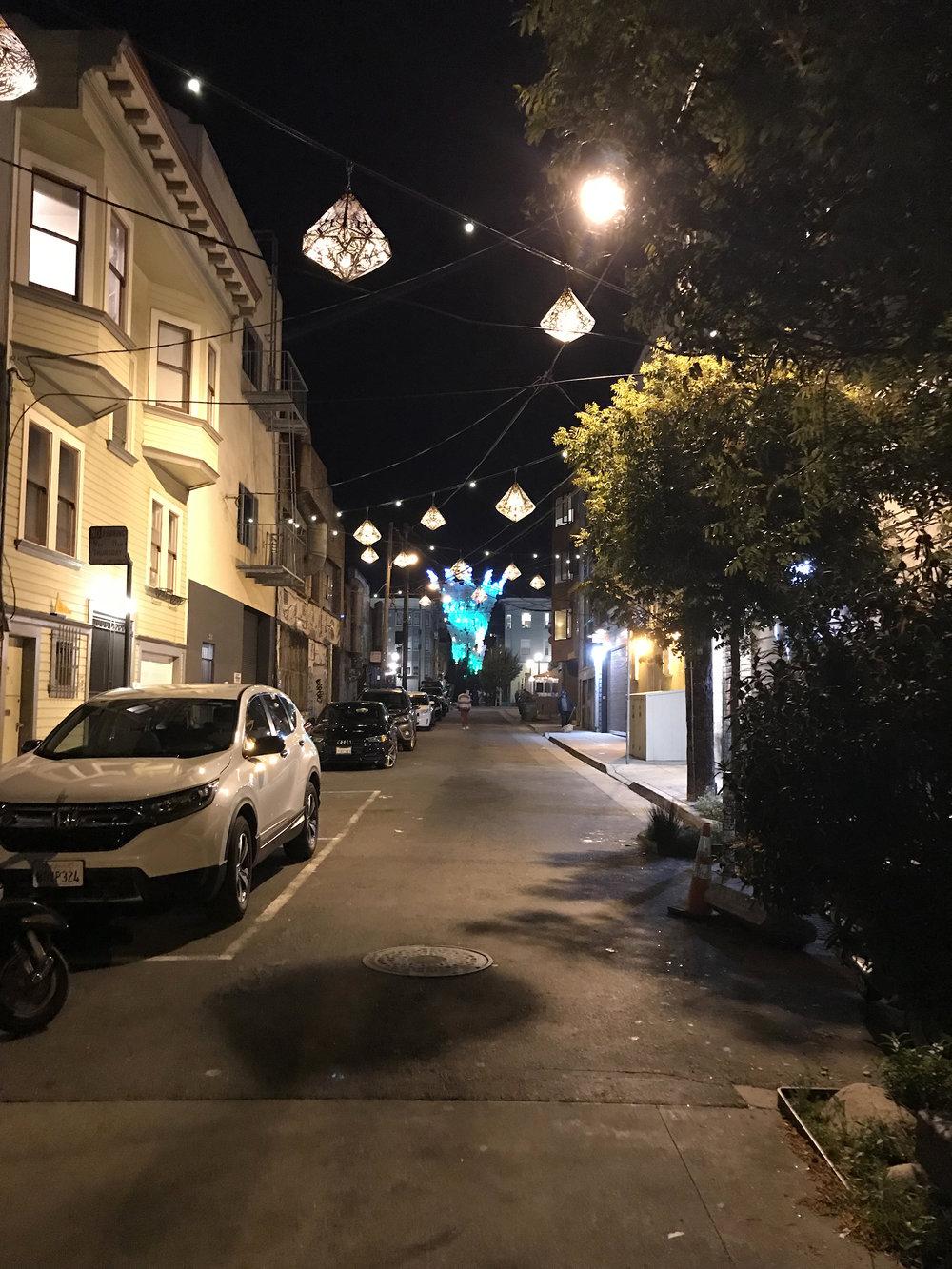 The new hanging lanterns light up Linden Alley after dark