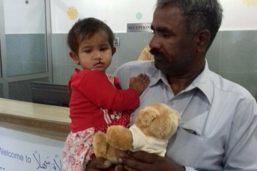 Mussart Iqbal, one, with her father Muhammed at the Cleft Hospital in Gujrat