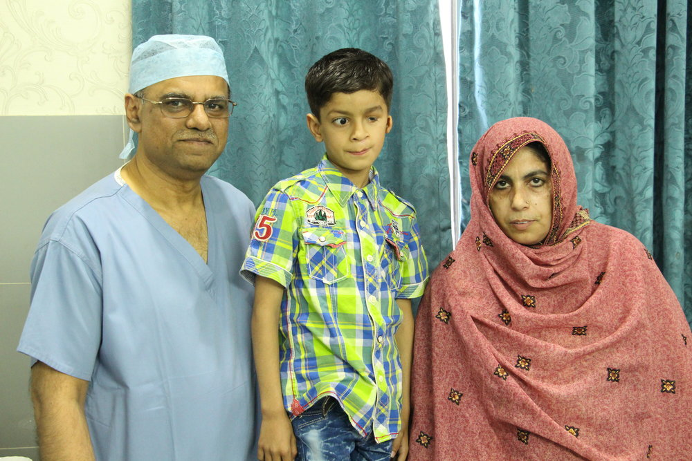 Dr Rafique with Faizan Ali and Faizan's mother Tahira