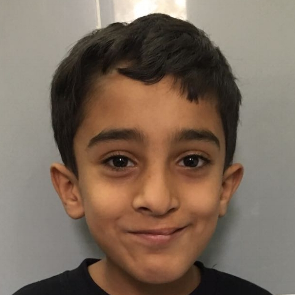 Arfat today aged 6, finally able to smile, and what a smile!