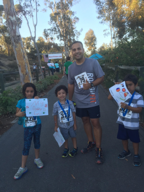 Michael's kids celebrate with him after the Peter's Canyon Trail Race.