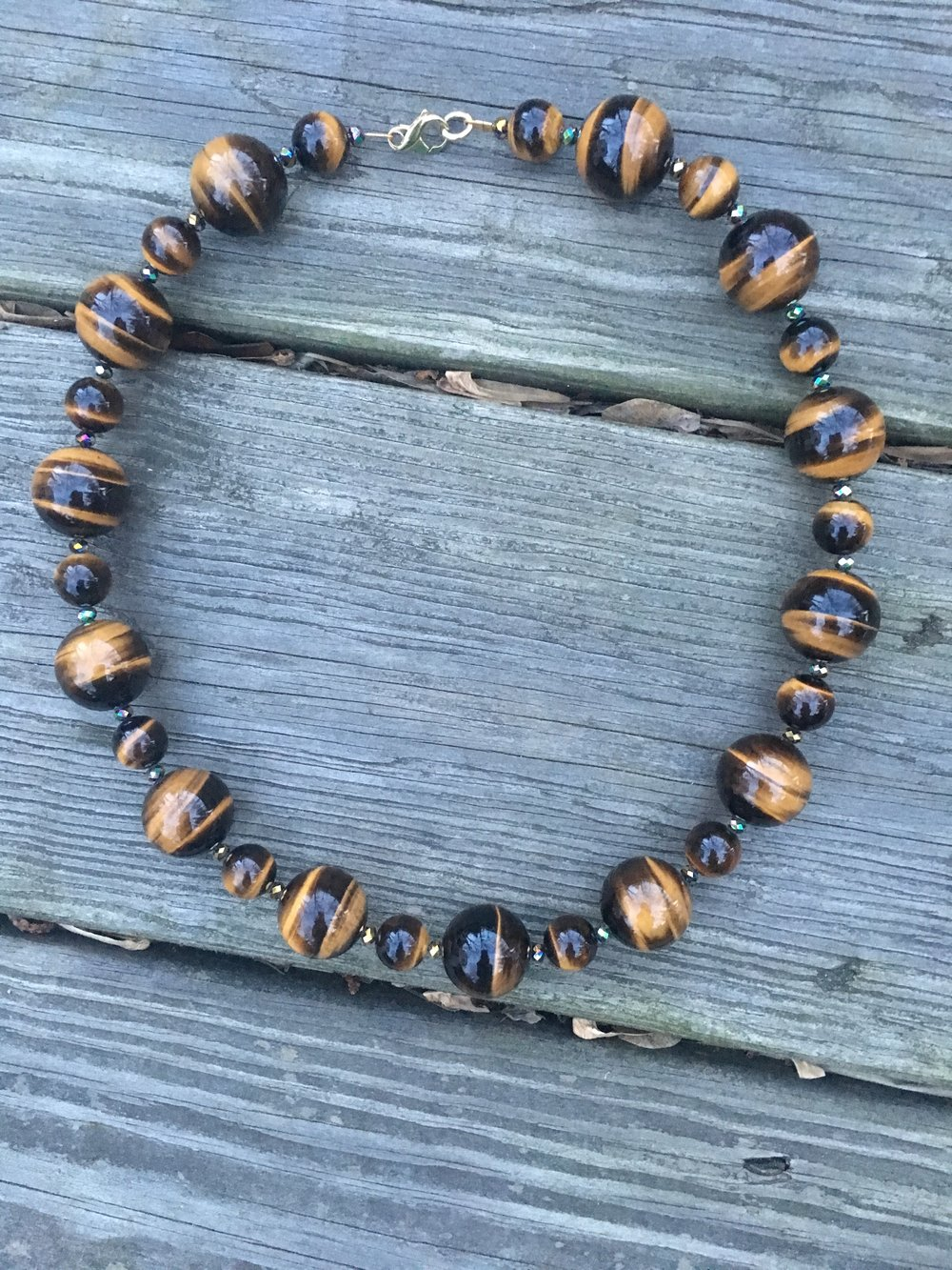 tigers eye NECKLACE  Tigers eye necklace with glass beads and gold filled clasp.