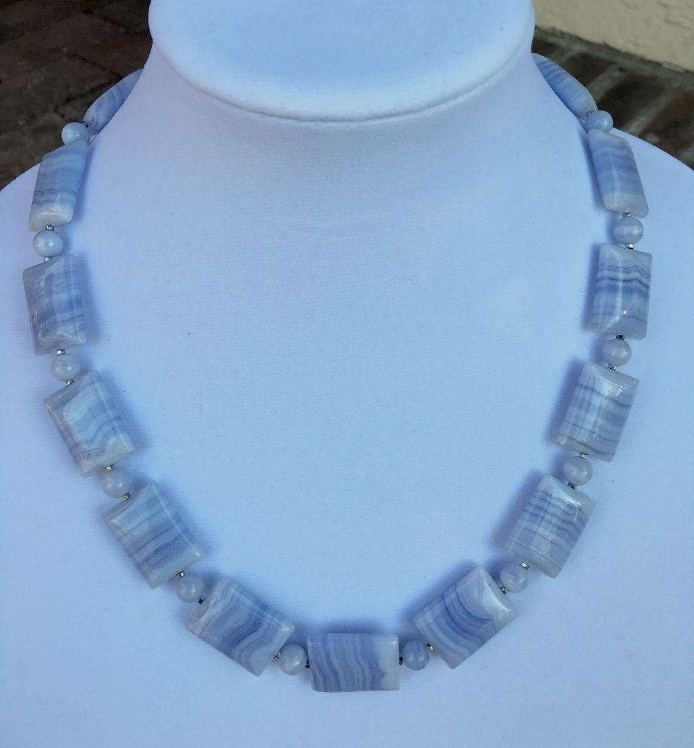blue lace agate NECKLACE   18 x 26 mm rectangular blue lace agate beads with very delicate lines. Very fine. 8 mm round blue lace agate beads. Price has jumped for blue lace agate and I can't find this nice quality anymore. Sterling silver clasp. 21 in. $350
