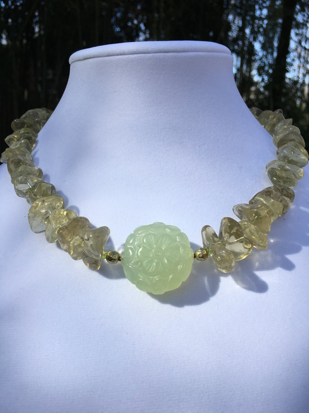 prehnite & cognac Quartz NECKLACE   30 mm round center carved prehnite bead, Cognac Quartz nugget beads, Peridot beads, gold filled clasp. 19 in. $150
