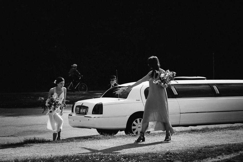 bride exiting limo at spanish banks
