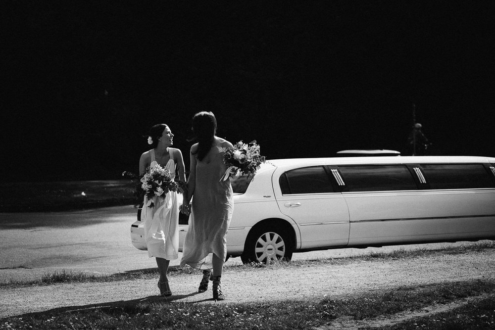 bride and maid of honour outside limo
