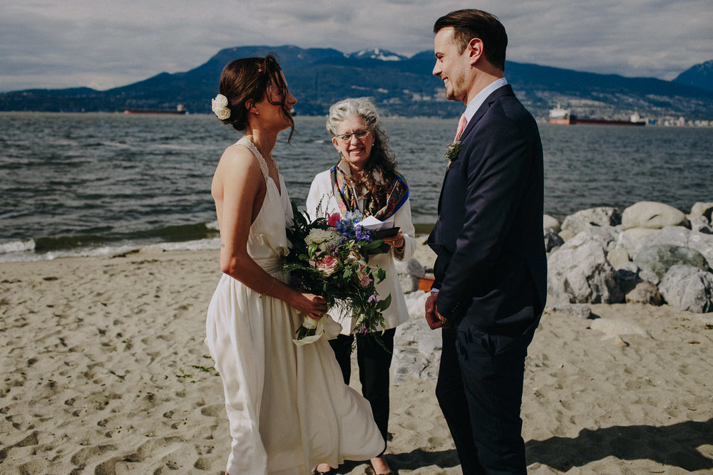 wedding ceremony on the beach at spanish banks