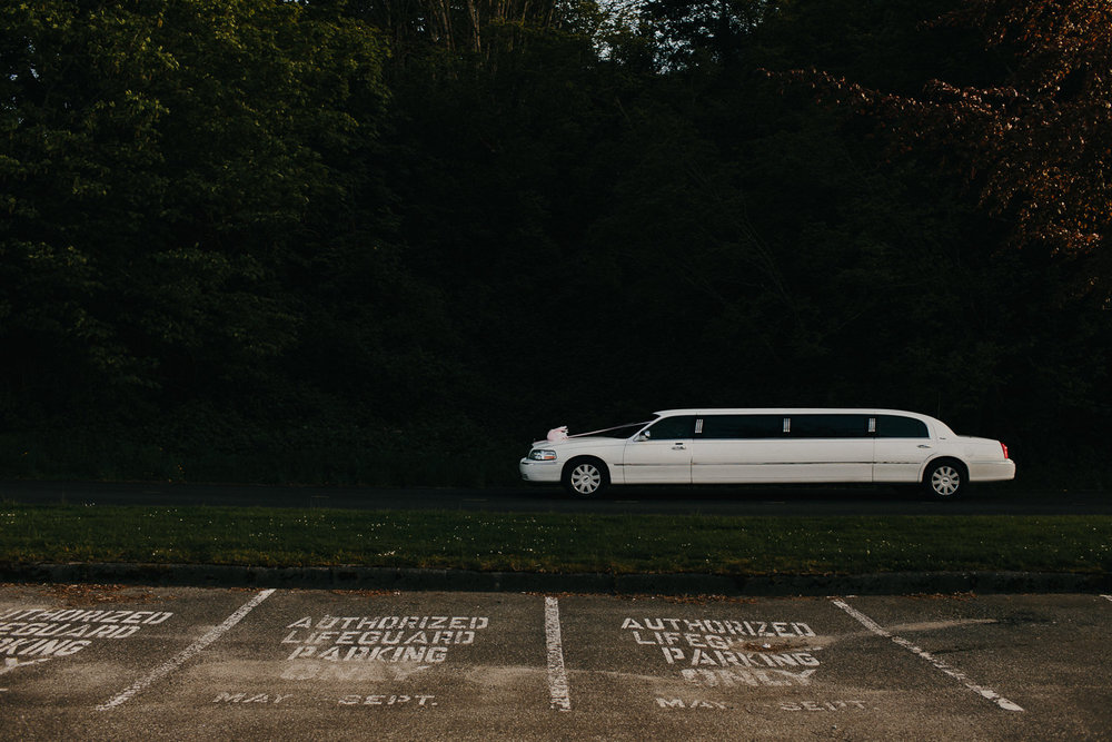 limo drives away from jericho beach wedding