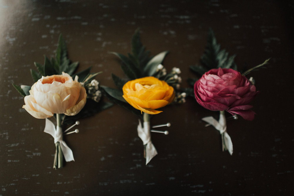 mixed ranunculus, leather leaf, white wax flower