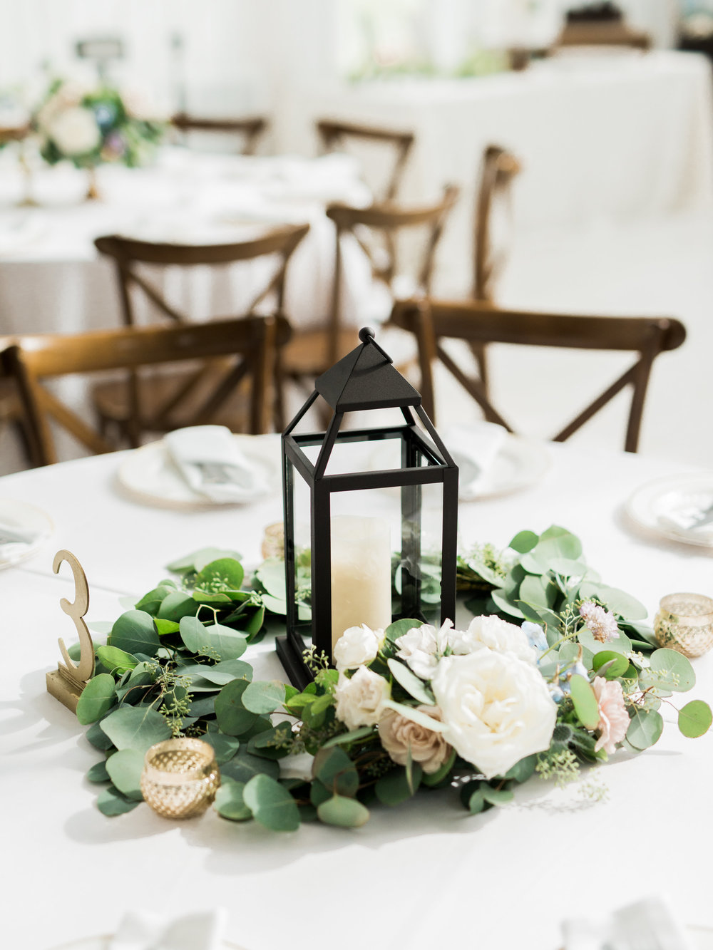 lantern + floral wreath | $75+