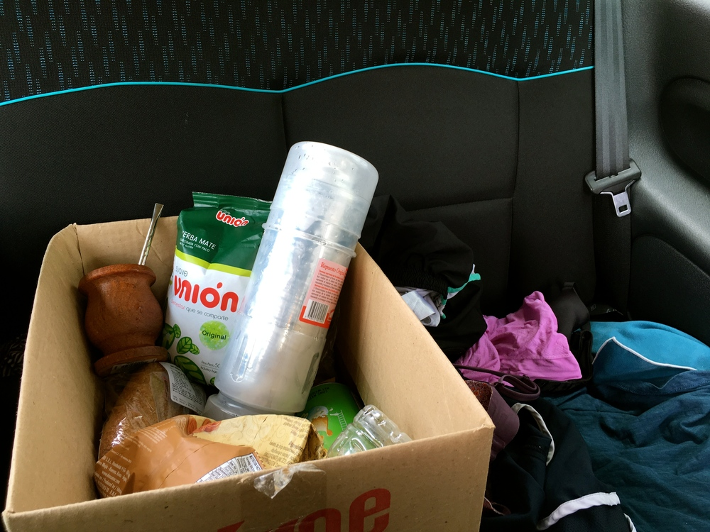 Our road trip box of supplies: maté, leaky thermos, maté gourd, bombilla, and plenty of ham n' cheese. (And dirty clothes)