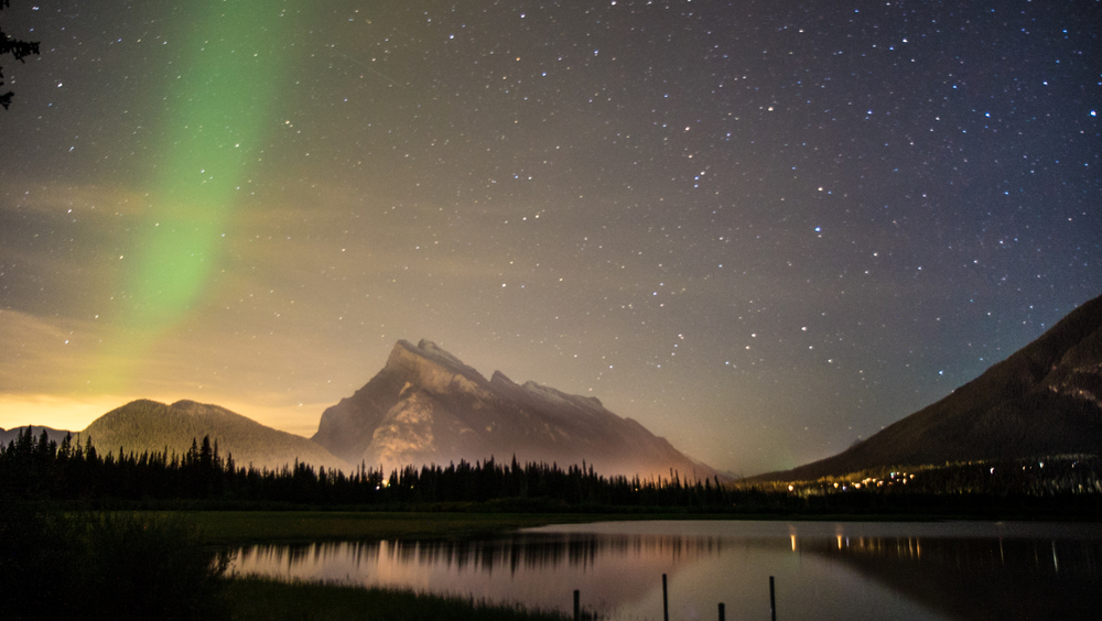 A ray of the Northern Lights over the town of Banff.