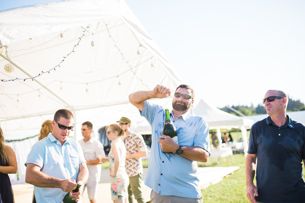 This father of the groom poppin' some champagne