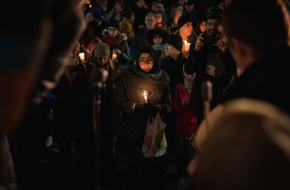 A girl in contemplation at the Vigil for the Quebec City Mosque shooting victims.