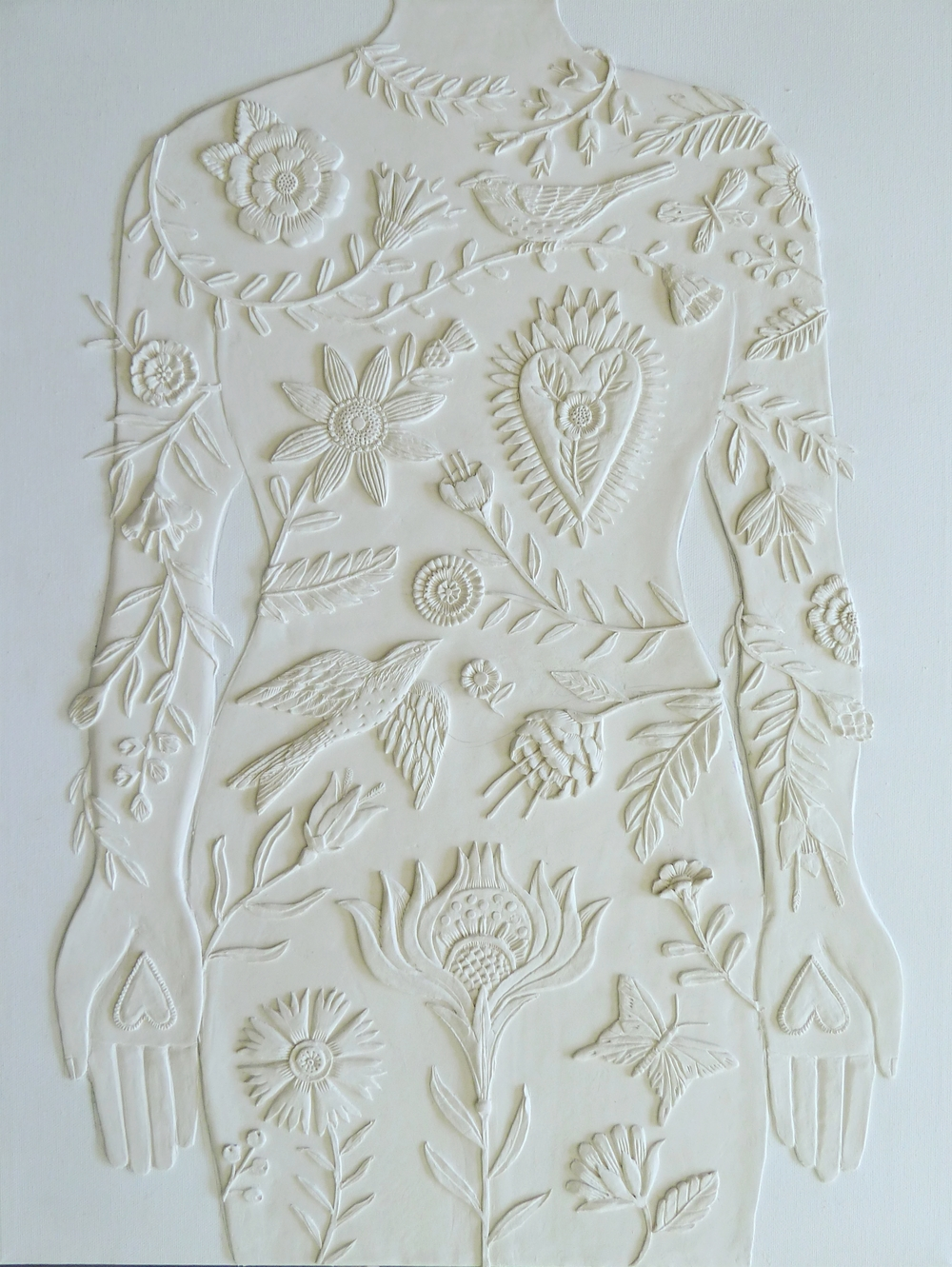 """Beginnings of """"A Body of Work"""" Unpainted paper clay on canvas."""