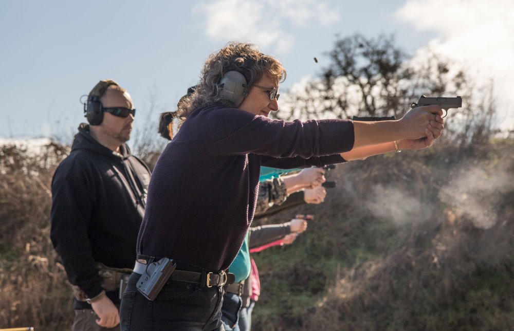 "Karen Wussting fires down range during one of LeBlanc's women's self-defense classes at the Albany Rifle and Pistol Club on Feb. 11, 2017. Though she has held her concealed carry permit in Oregon for multiple years, she has never actively carried firearms. ""I'm hoping to build my confidence with the gun so that I will feel more comfortable keeping it on me more often,"" Wussting said."