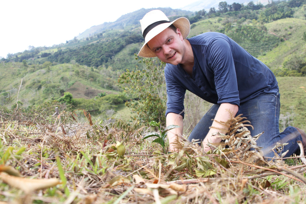 Happy farmer planting Typica in February 2015.jpg