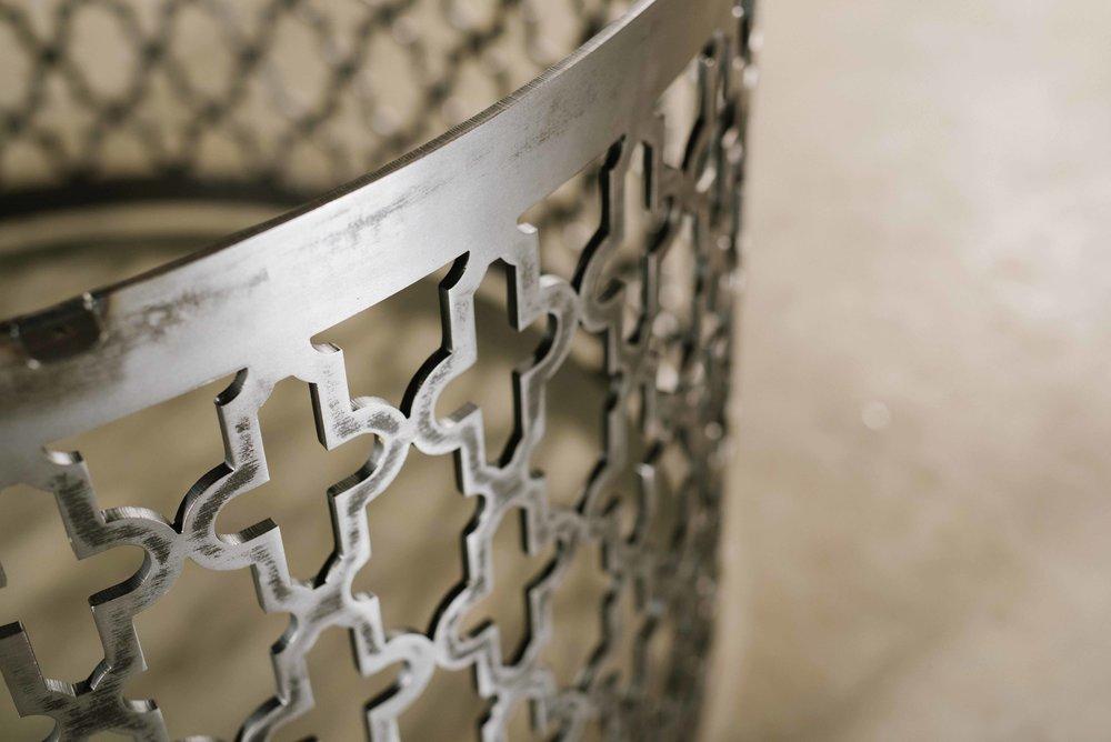 with laser-cut, quatrefoil pattern.