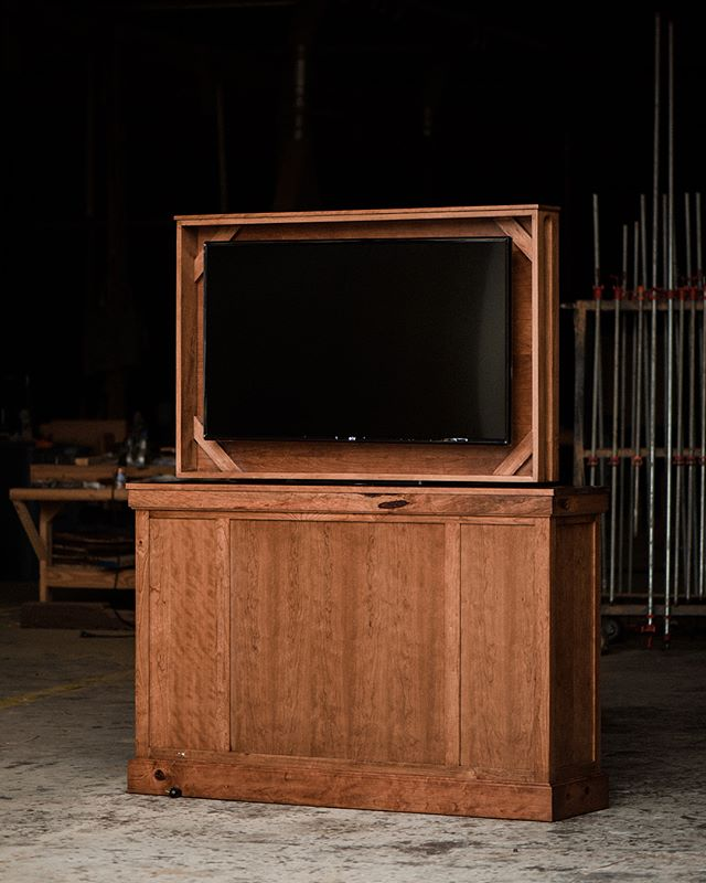 Check out this one of a kind Custom Pop TV Console crafted from solid hand selected knotty Appalachian cherry. Looks like the television is going to have some competition. {shown in SOLID HAND SELECTED KNOTTY APPALACHIAN CHERRY + STAINED IN A RICH MOCHA + SEALED IN SATIN VARNISH + EMBELLISHED WITH FULL REMOTE & 360 DEGREE SWIVEL}