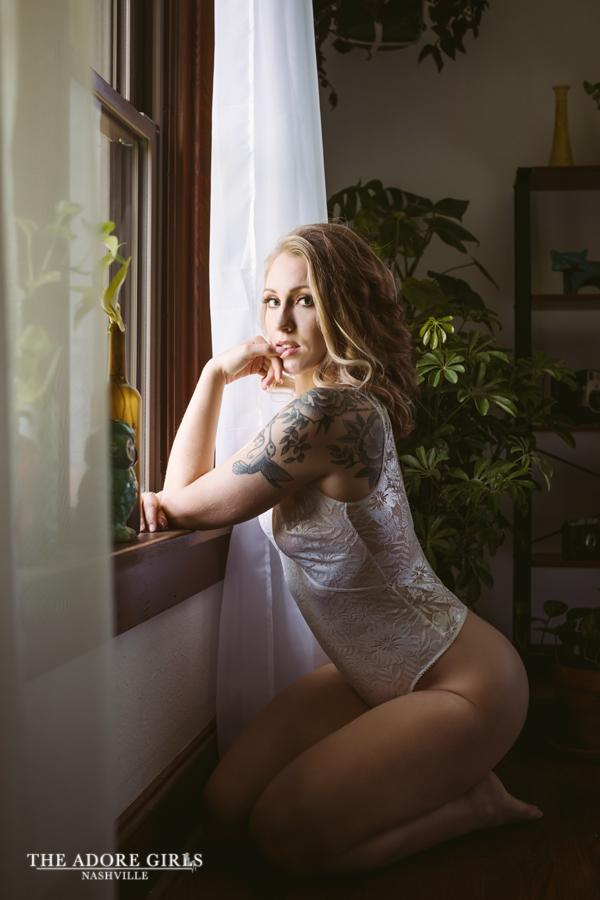 The Adore Girls Boudoir Nashville lace bodysuit in window