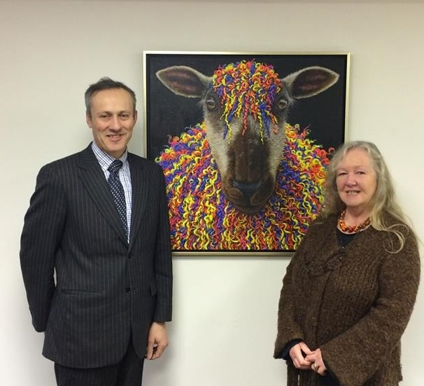 Managing Director David Midgley with the artist Teresa Boast and the finished picture.