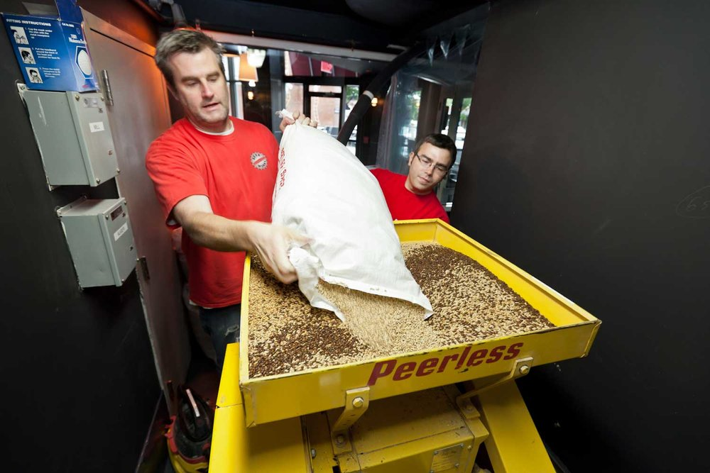Nate Heck and George Schwartz  grinding the malt in preparation for making the EIMS IPA.jpg